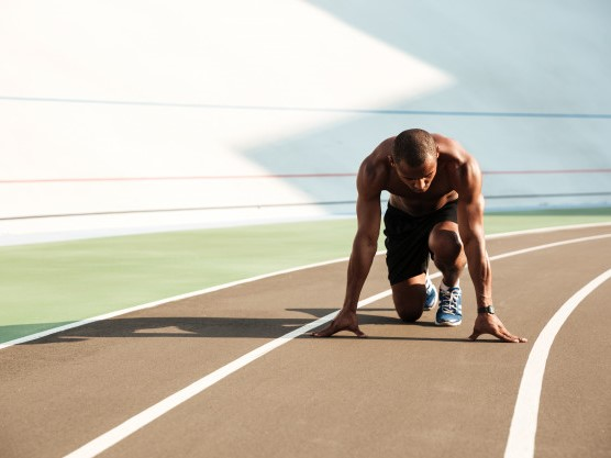 young-afro-american-sports-man-starting-position-ready-start-sports-track-stadium_171337-9465-1.jpg